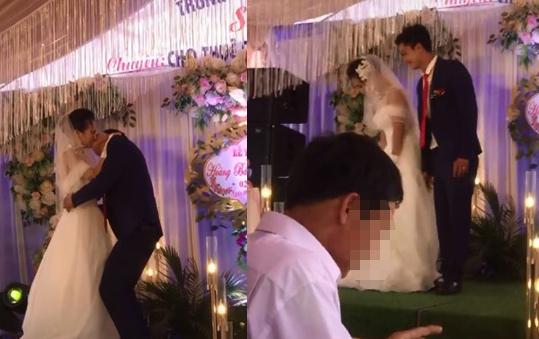 Bị chú rể ghì chặt hôn ngấu nghiến trước mặt quan khách, phản ứng của cô dâu gây bất ngờ-1