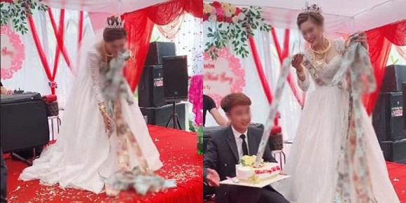 Xuýt xoa cô dâu trẻ cổ đeo đầy vàng còn được chồng tặng bánh kem ngập tiền ở đám cưới-1